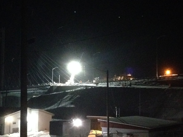 Crews worked late Sunday night on the Nipigon River Bridge, with the Ministry of Transportation pledging to safely restore the bridge as soon as possible. (Jeff Walters/CBC)